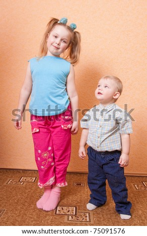 boy and girl indoor - stock photo