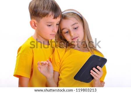 Boy and girl looking at e-book - stock photo