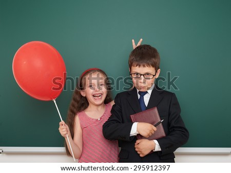 boy and girl near the school board - stock photo