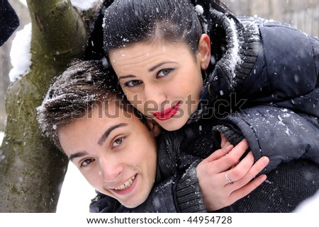 boy and girl playing in snow - stock photo
