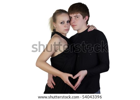 Boy and girl posing on a white background - stock photo