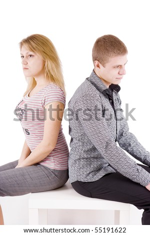 boy and girl sitting on a chair back to back - stock photo