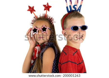 boy and girl wearing cute patriotic sunglasses - stock photo