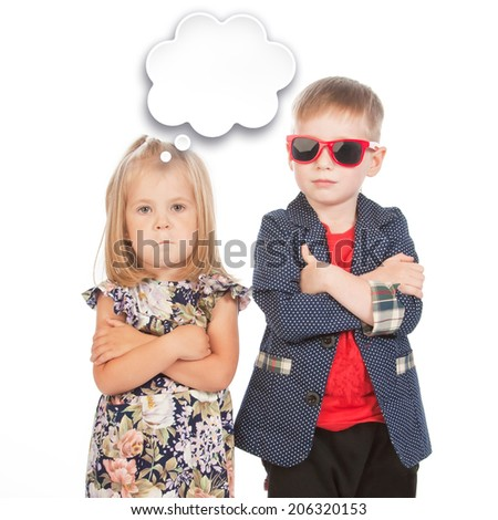 Boy and girl with arms across and a bubble template, studio portrait - stock photo
