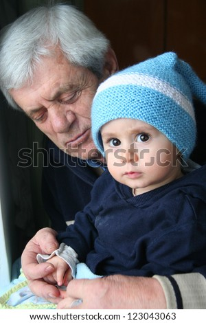 boy and his grand father,portrait - stock photo