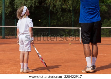 boy and his tennis coach - stock photo