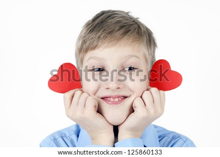 Boy and red hearts. - stock photo