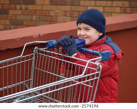 boy and trolley - stock photo