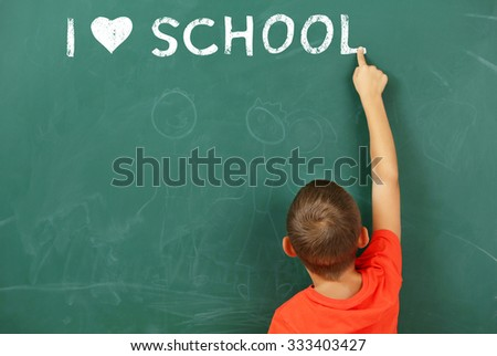 Boy at the blackboard. I love learning concept - stock photo