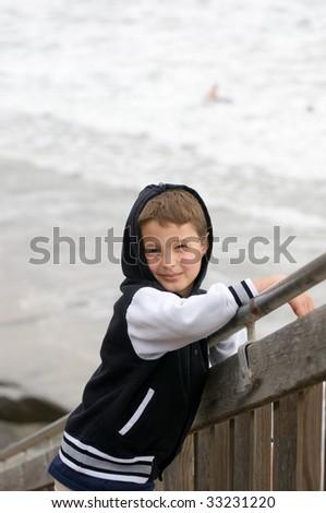 Boy at the shore - stock photo