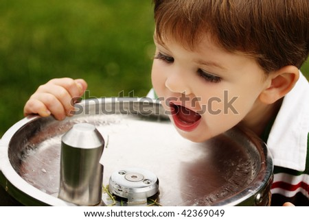 Boy at Water Fountain - stock photo