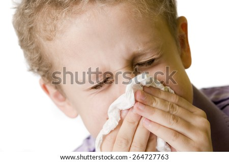boy blow nose closed eyes - stock photo