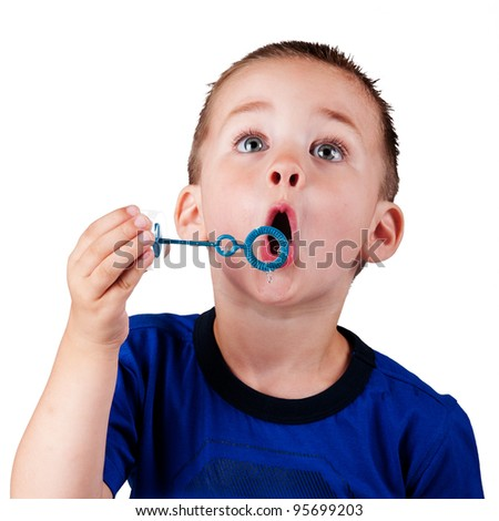 Boy blowing bubbles isolated - stock photo