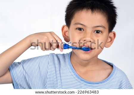 boy brushing teeth,  on white - stock photo