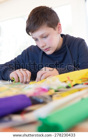 Boy build a kite  - stock photo