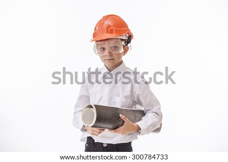 Boy child in a protective helmet and goggles with a construction drawing. Studio, isolated, Builder, white. - stock photo
