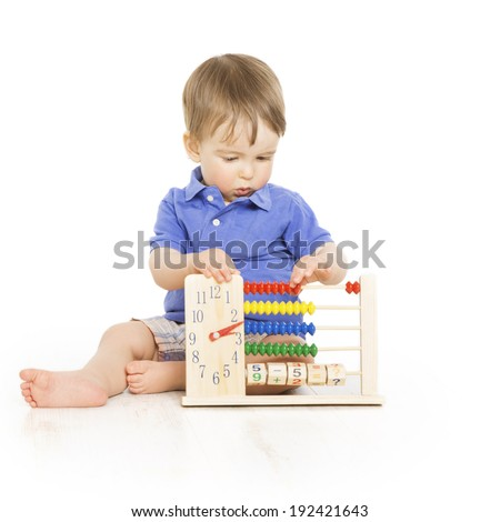 Boy child with abacus clock counting, smart little kid study lesson, education development  - stock photo
