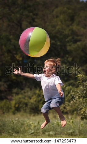Boy children playing ball - stock photo