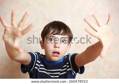 boy close up photo show fear emotion with hand gesture - stock photo