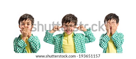 Boy covering his eyes, his mouth and his ears - stock photo