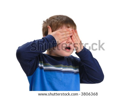 Boy covering his eyes with his hands, isolated on white - stock photo