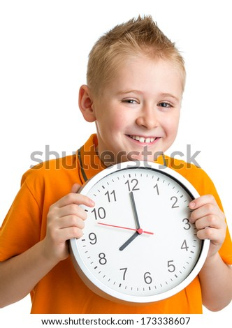 boy displaying eight o'clock time in studio isolated - stock photo