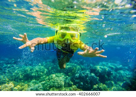 Boy dives in a tropical sea - stock photo