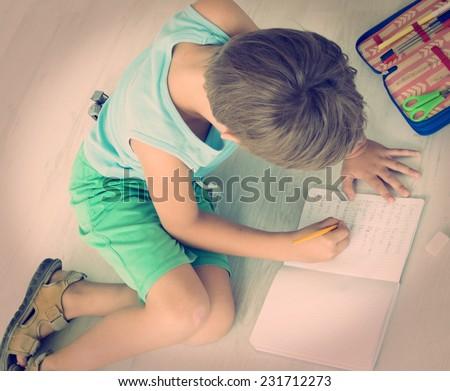 boy doing his homework  - stock photo