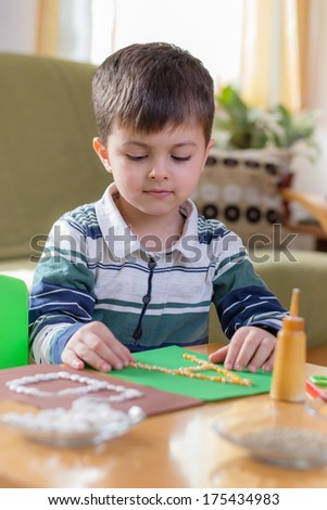Boy doing homework - stock photo