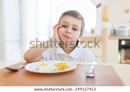 Boy don't want to eat his breakfast - stock photo