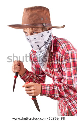 boy dressed up as bandit with two knives on white - stock photo