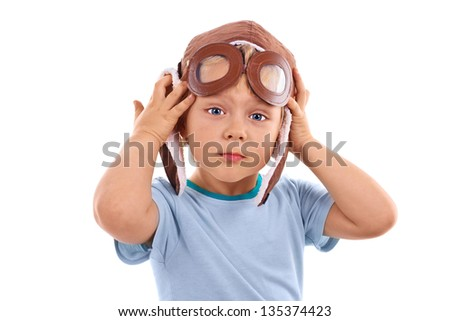 Boy dressed up in pilots hat isolated over white - stock photo