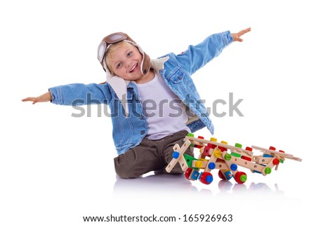Boy dressed up in pilots jacket and hat isolated over white - stock photo