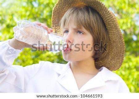 boy drinking water - stock photo