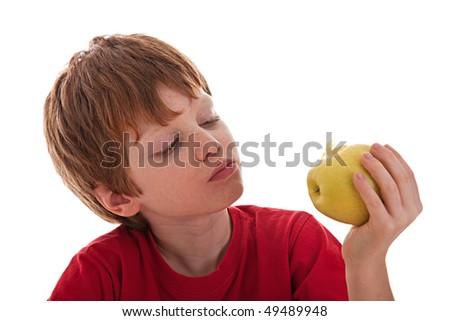 boy eating a green apple - stock photo