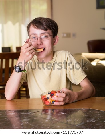 Teen eating healthy snacks stock photos illustrations and vector art