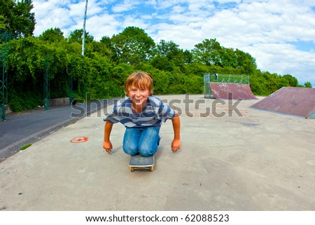 boy enjoys skating on his skateboard - stock photo
