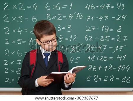 boy exercise math on school board - stock photo
