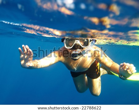boy floats under water in the sea - stock photo