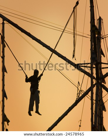 boy having fun in a attraction - stock photo