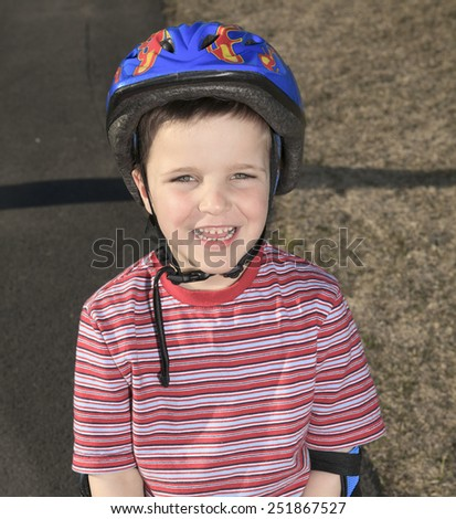 Boy having fun, rollerblading outdoor on a sunny summer day - stock photo