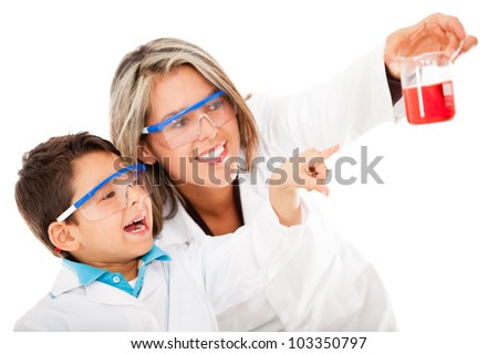 Boy helping mum with an experiment at the lab - isolated over white - stock photo