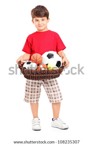 Boy holding a basket with balls, isolated on white background - stock photo