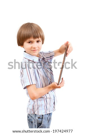 boy holding a tablet computer - stock photo