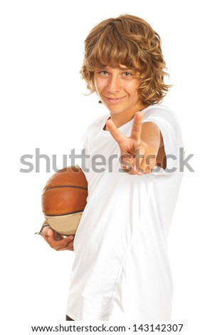 Boy holding basketball and showing victory sign hand gesture isolated on white background - stock photo