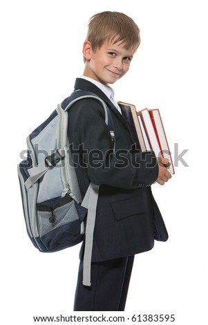 Boy holding books isolated on a white background - stock photo
