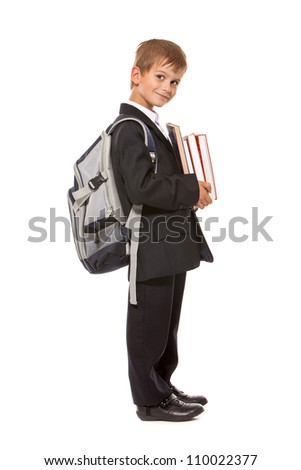 Boy holding books isolated on a white background. Back to school - stock photo