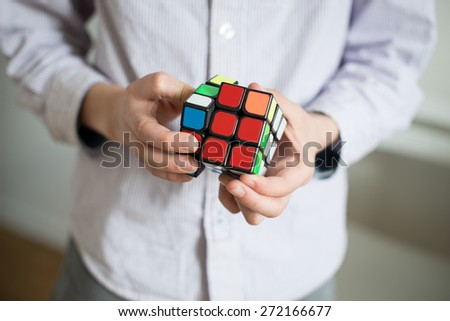 Boy holding cube/selective focus - stock photo