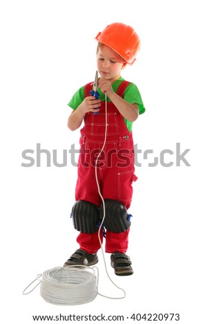 Boy holding electrical wire with pliers isolated on white - stock photo