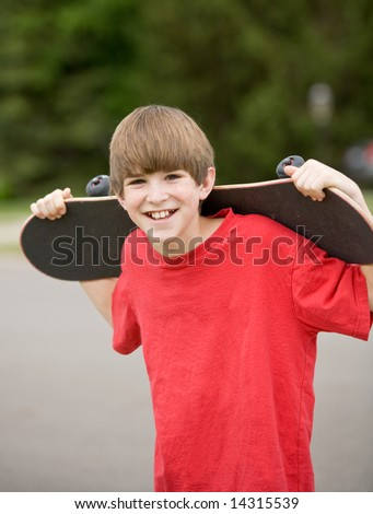 Boy Holding His SkateBoard - stock photo